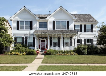 White home in suburbs with front porch - stock photo