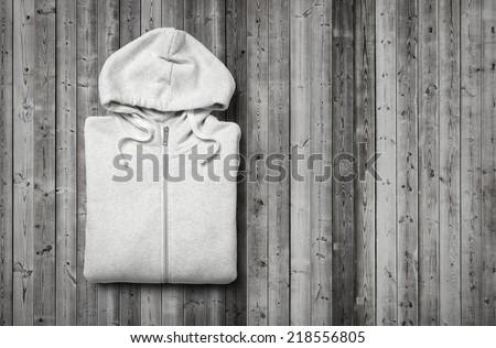 White hoodie on dark wood background - stock photo
