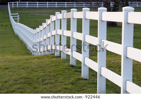 White horse fence on a small farm in the country - stock photo