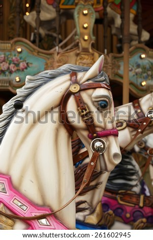 White horse in a carousel at the fair - stock photo