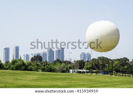White Hot Air Balloon in a park in Tel Aviv, Israel. - stock photo
