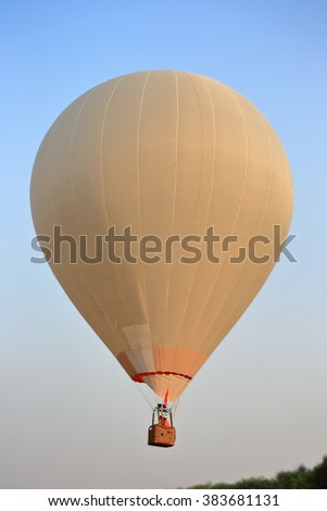 White Hot air balloon on blue sky - stock photo