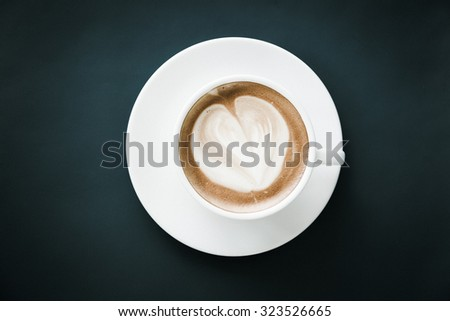 White hot coffee cup with heart shape surface - stock photo