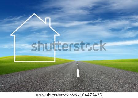 White house beside asphalt road - stock photo