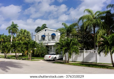 White house in tropical setting - stock photo
