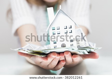 White house, money and human hands. Finance concept