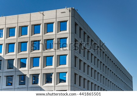 White house on blue sky background. Office Modern house with blue windows. Row of windows. Copenhagen, Denmark. Building full of windows in perspective. Sunny day. Contemporary architecture. Maersk. - stock photo