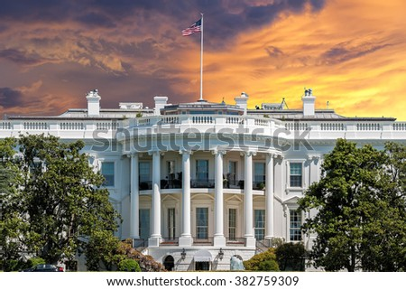 White House on deep red sunset background - stock photo