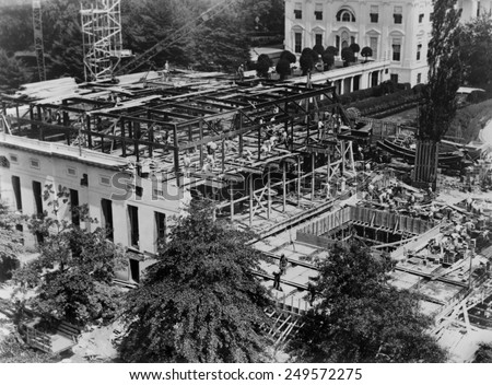White House West Wing construction, 1934. FDR engaged an architect, Eric Gugler, to redesign the West Wing in 1933. - stock photo