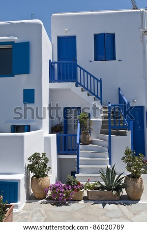 White house with blue shutters in Mykonos, Greece - stock photo
