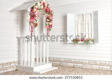 White house with flowers and white porch. Provence. - stock photo