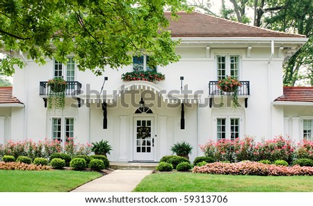 White House with Pink Flowers - stock photo