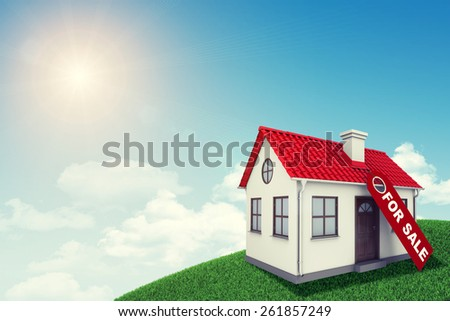 White house with red roof for sale on green grassy hill. Background sun shines brightly. Blue sky - stock photo