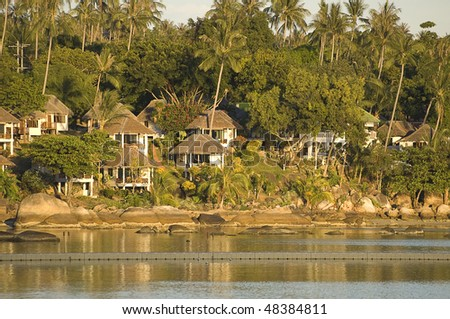 White houses in a sunset bay - stock photo