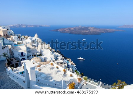 White houses of Fira, Santorini with Santorini's famous volcano in the background