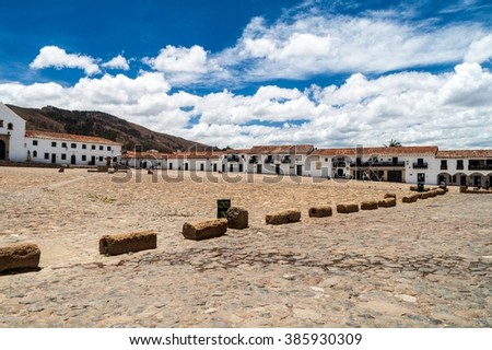White houses on Plaza Mayor square in colonial town Villa de Leyva, Colombia. - stock photo