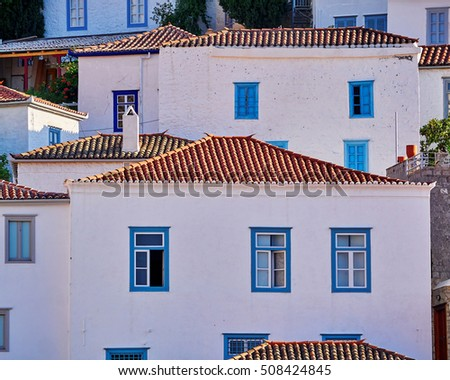 white houses with blue windows, Hydra island town, Greece
