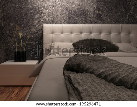 White huge bed standing against dark black wall - stock photo