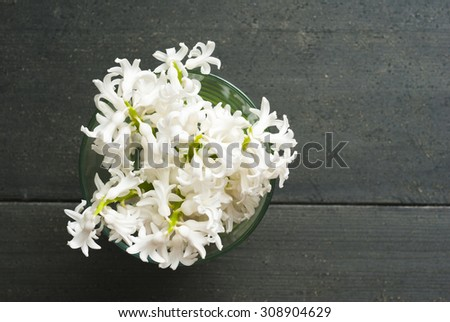 white hyacinth flowers on black wooden table
