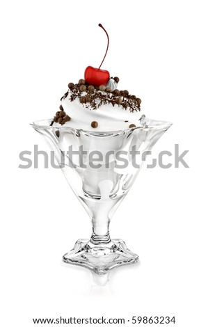 white ice cream topped with red cherry and powdered with chocolate ships and balls. Isolated on white. - stock photo