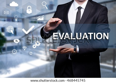 "White icon with text ""Evaluation"" in the hands of a businessman. Business concept. Internet concept."