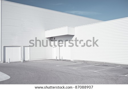 White industrial architecture - Outdoor view of a white faded store architecture - stock photo