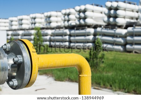 White industrial butan bottles.Compressed natural gas - stock photo
