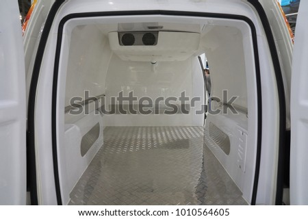 White interior of the cargo area of the new fridge van. Refrigeration unit inside.