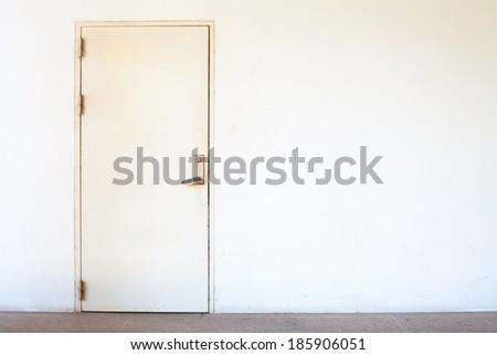 white iron safety door on white wall - stock photo