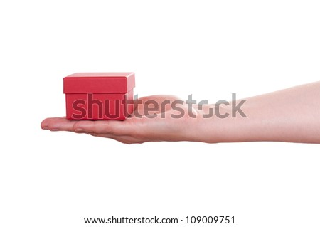 White isolated female hand is holding a red gift box - stock photo