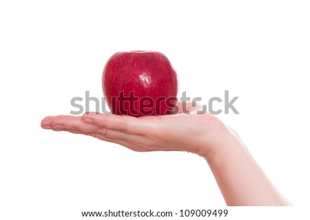 White isolated red apple in a female hand - stock photo