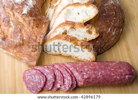 White Italian brick oven delicious fresh baked bread sliced with sausage for sandwich - stock photo
