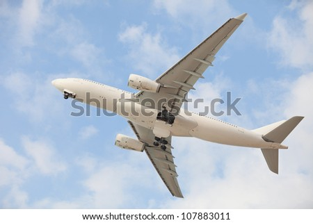 White jet aircraft in blue sky - stock photo