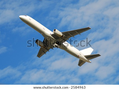 White jet airplane flying overhead