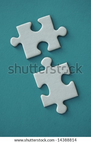 White jigsaw pieces on blue background