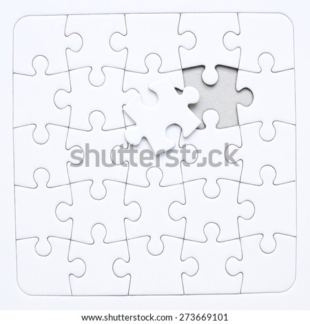 White jigsaw puzzle about to be solved
