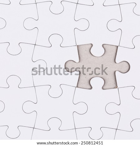 white jigsaw puzzle as a background - stock photo