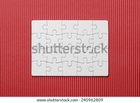 White jigsaw puzzle on red, wave background  - stock photo
