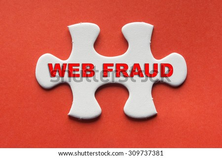 White jigsaw puzzle with a written word web fraud on a red background. - stock photo
