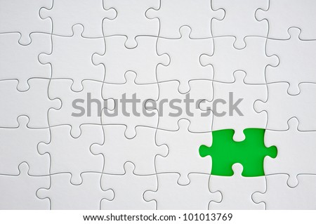 White jigsaw puzzle with missing piece - stock photo