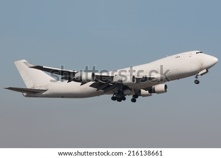 White Jumbo Jet climbing out of the runway - stock photo