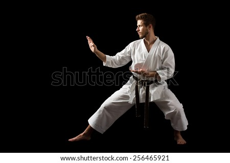 White Karate Fighter Isolated On Black With Copyspace - stock photo