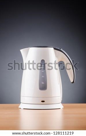 White kettle against grey background - stock photo