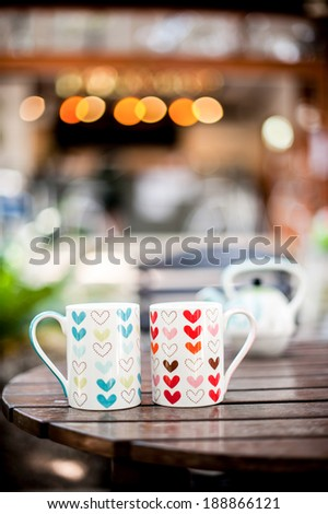 White kettle in the coffee shop. With a glass heart motifs - stock photo