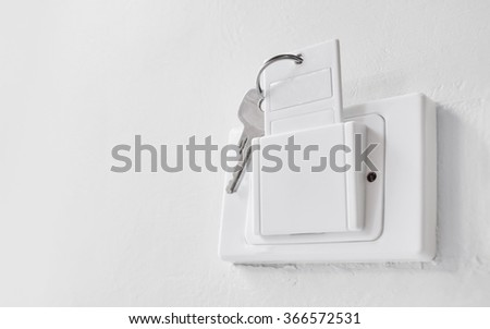 white key card in electronic lock