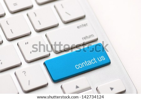 white keyboard with contact us key