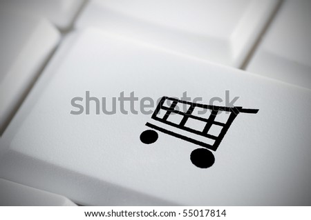 White keyboard with shopping cart symbol - stock photo