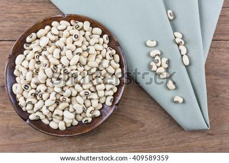 White kidney bean on wooden background./ White kidney bean - stock photo