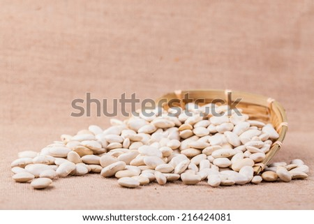 white kidney bean studio shot in bamboo container - stock photo