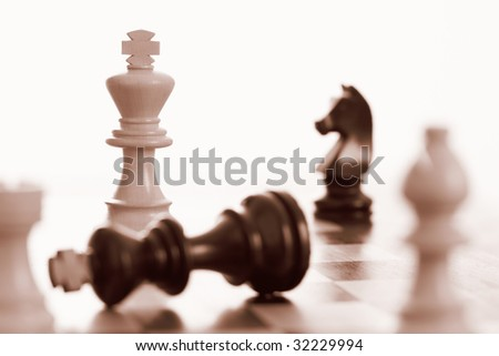 White king wins chess game sepia tone - stock photo